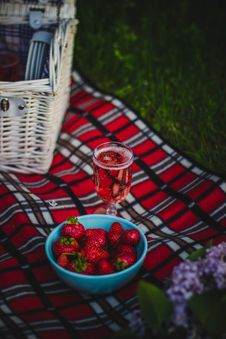 Free Clear Wine Glass With Wine Near Strawberry Fruit On Red White And Black Plaid Textile Stock Image - 83059411