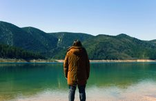 Free Man Looking Across A Lake Stock Photography - 83059482