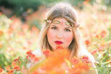 Free Woman In Flower Field Wearing Headband Stock Photography - 83059512