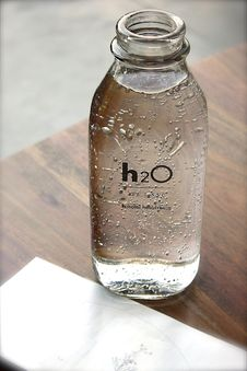 Free Clear Glass H2o Bottle Royalty Free Stock Photo - 83059725