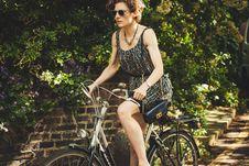 Free Woman Riding White And Black Cruiser Bike Near Grey Wall Bricks Stock Photos - 83059743