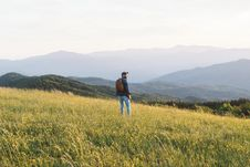 Free Man Standing On Green Grassy Field Stock Image - 83059771