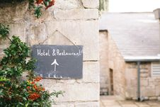 Free Hotel And Restaurant Signage On Brown Concrete Wall Royalty Free Stock Photos - 83059778