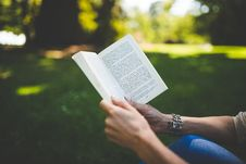 Free Person Holding And Reading Book During Daytime Stock Photo - 83059910