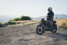 Free Person In Black T Shirt Sitting On Black Motorcycle Overlooking Sea During Daytime Stock Photo - 83060000