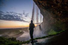 Free Person At Waterfall At Sunset Stock Photos - 83060023