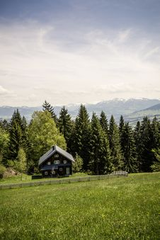 Free Brown Wooden House Neat Trees On Mountain Under Grey Clouds During Daytime Royalty Free Stock Photography - 83060067