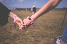 Free 2 Person Holding Each Other Wearing Pink Friendship Bracelet During Daytime Royalty Free Stock Photo - 83060085