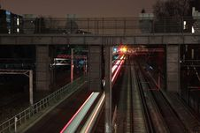 Free Train Railway Under Gray Overpass During Nightime Royalty Free Stock Image - 83060206