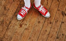 Free Person In Red Low Tops In Brown Wooden Floor Stock Image - 83060431