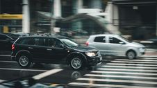 Free Black Suv Beside Grey Auv Crossing The Pedestrian Line During Daytime Royalty Free Stock Image - 83060456