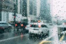 Free Traffic On Rainy Streets Royalty Free Stock Image - 83060486