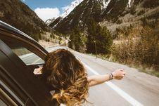 Free Woman Riding In Car Through Mountains Royalty Free Stock Image - 83060576