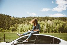 Free Woman On Top Of Car Royalty Free Stock Photography - 83060617