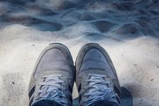 Free Grey Shoes On Top Of Grey Sand Stock Image - 83060681