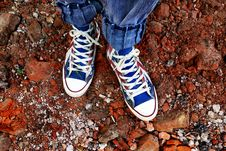 Free Person In Blue Denim Jeans In Blue And White Sneakers Stock Images - 83060794