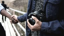 Free Person Holding Black Canon Dslr Camera Wearing Blue Blazer During Daytime Royalty Free Stock Photography - 83060937