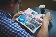 Free Man In Blue And White Gingham Print Shirt Reading Car Magazine Royalty Free Stock Images - 83061049