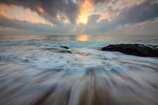 Free Time Lapse Photo Of Water Current And Brown Rock Under White And Yellow Cloudy Sky Stock Photography - 83061072