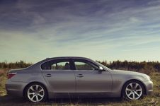 Free Silver Sedan Parked Far From Green Trees Under Blue Sky During Daytime Stock Photo - 83061090