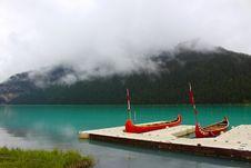 Free Canoes On Lake Near Mountain Royalty Free Stock Photos - 83061288