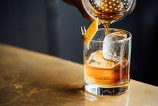 Free Brown Liquid Pouring On Clear Shot Glass Stock Photo - 83061370