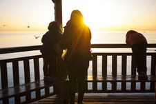 Free Woman And 2 Kids On Dock House Watching Sunset Royalty Free Stock Photo - 83061415