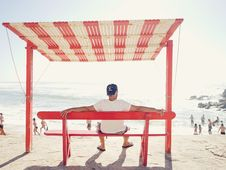 Free Man On Beach Bench Stock Images - 83061654