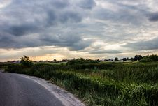 Free Clouds Over Grass Next To Road Stock Image - 83061771