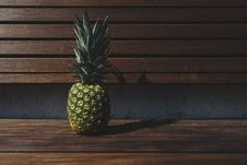 Free Pineapple On Wooden Bench Royalty Free Stock Photo - 83061865