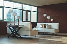 Free Grey Throw Pillow On White Sofa Near The Window Royalty Free Stock Images - 83062149