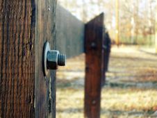 Free Selective Focus Photography Of Grey Bolt Pierced In Brown Wooden Fence During Daytime Stock Image - 83062171