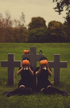 Free People With Pumpkins On Graveyard Royalty Free Stock Image - 83062266