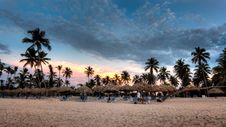 Free Nipa Hat Surrounded With Palm Trees Under White Clouds And Blue Skies Under Orange Sunset Stock Images - 83062654