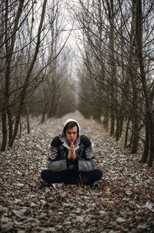 Free Man Wearing Gray Black Zip Hoodie Jacket Praying In Between Black Tree During Daytime Royalty Free Stock Photo - 83062665