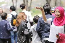Free Woman Wearing Red Hijab Behind Person Wearing Black Jacket Stock Photos - 83062773