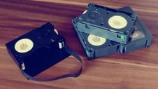 Free Betamax Tapes On Top Of Brown Wooden Surface Royalty Free Stock Photography - 83062797