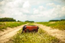 Free Leather Bag On Country Road Royalty Free Stock Image - 83062836