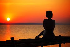 Free Silhouette Of Woman Sitting On Dock During Sunset Stock Image - 83062851