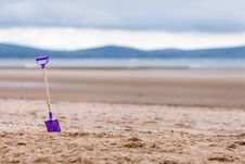 Free Purple Shovel On Sand Bottom Focus Camera Royalty Free Stock Photography - 83062867