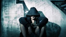 Free Person Wearing Black Zip Hoodie Sitting In Front Of Gray Wooden Plank Wall During Nighttime Stock Photo - 83062930