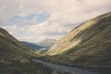 Free Concrete Road Between Green Mountains Royalty Free Stock Images - 83063039