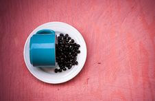 Free Blue Ceramic Tea Cup With Beans On Plate Stock Photo - 83063110