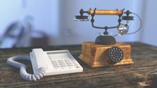 Free White Electric Home Phone Close To Rotary Phone On Table Royalty Free Stock Photos - 83063208