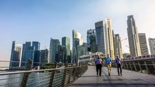 Free Three Men Walking On Bridge In Front Of High Rise Buildings At Daytime Stock Photos - 83063243