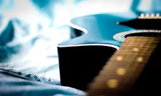 Free Black Acoustic Guitar In Grey Textile Close Up Photo Royalty Free Stock Photos - 83063278