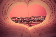 Free Chrome Musical Instrument Viewed On Heart Shaped Music Score Book Royalty Free Stock Photo - 83063355