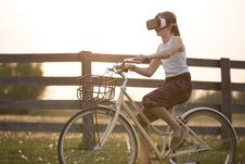 Free Girl Wearing Vr Box Driving Bicycle During Golden Hour Stock Photos - 83063473