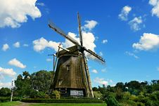 Free Brown And Black Windmill Under Cumulus Clouds Surrounded By Green Leaf Trees Stock Image - 83063491
