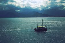 Free Sailboat Sailing Near Mountains Under Cloudy Sky Stock Photo - 83063560